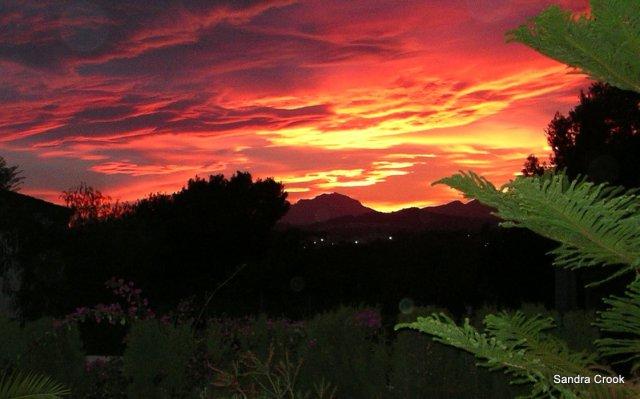 The sun sets behind Sierra Bernia, Costa Blanca, Sp;ain.