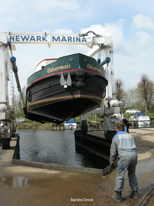 With wheelhouse dismantled and stored inside the boat, Desormais is lifted from the water at Newark, Nottinghamshire.