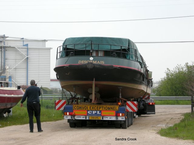 Negotiates the winding road to the water's edge where we climb up to reassemble her wheelhouse.